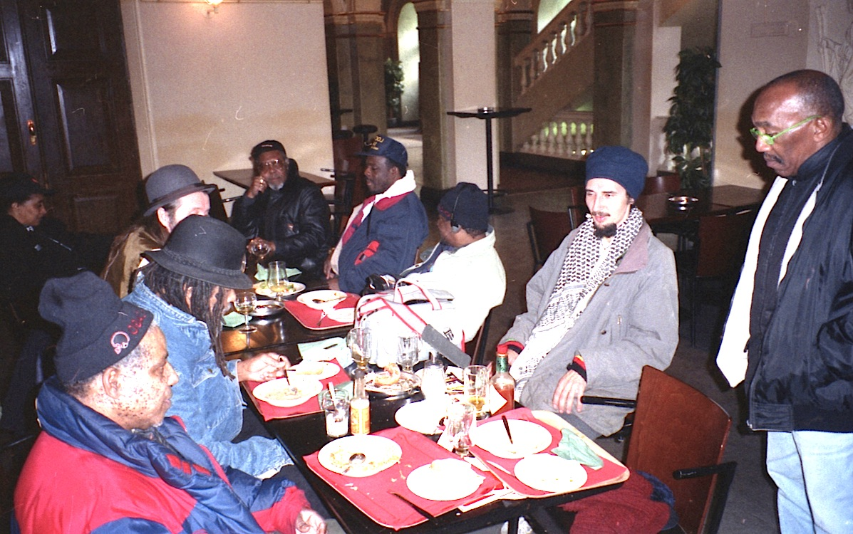 Rolando Alphonso, Lloyd Brevett, Mazhar, Lloyd Knibb, Devon James, Lester Sterling, Ras Claude at a table somewhere in Helsinki, Finland 1996